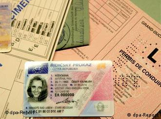 The new plastic driver's license sits on top of older licenses