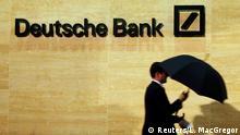 05.12.2013 A man walks past Deutsche Bank offices in London December 5, 2013. REUTERS/Luke MacGregor/File Photo Copyright: Reuters/L. MacGregor