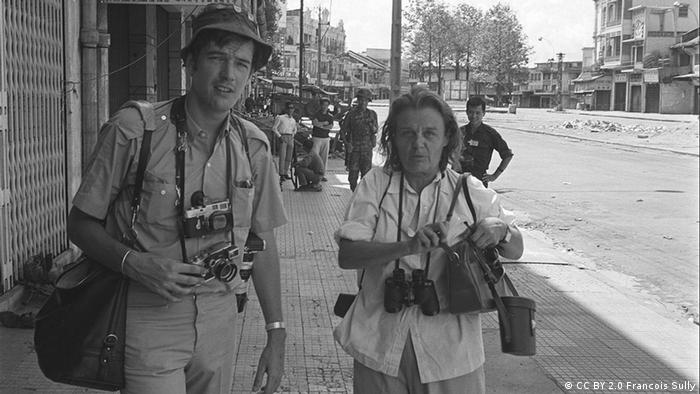Hollingworth and a colleague on a Saigon street during the Tet Offensive