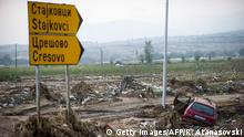 7.08.2016 A flooded vehicle is pictured by the ringroad close to the village of Stajkovci, near Skopje, on August 7, 2016. Fierce storms packing strong winds and torrential rains overnight killed at least 20 people in Macedonia's capital of Skopje, the health minister said August 7. The freak weather included winds blowing at more than 70 kilometres (43 miles) an hour and resulted in flash floods and landslides, with cars swept away by the violent torrents. / AFP / Robert ATANASOVSKI (Photo credit should read ROBERT ATANASOVSKI/AFP/Getty Images) Copyright: Getty Images/AFP/R. Atanasovski