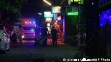 11.08.2016 In this screen grab taken from video, emergency services at the scene of a bomb attack, in Hua Hin, Thailand, Thursday, Aug. 11, 2016. Two small bombs exploded Thursday night in Thailand's popular seaside resort town of Hua Hin, leaving at least one person dead and 20 others injured, according to Thai media. (AP)   Reuters/L. Foeger