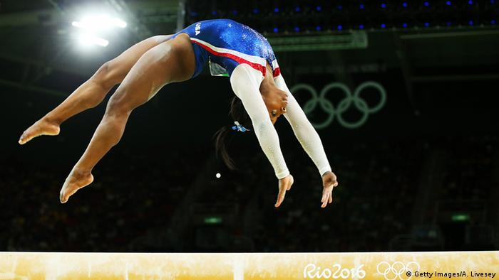 Simone Biles doing a flip in the Rio Olympics