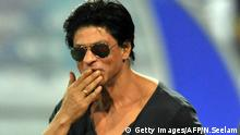 Kolkata Knight Riders owner and Bollywood actor Sharuk Khan gestures on the grounds prior to the start of the Champions League Twenty20 qualifying pool cricket match between Kolkata Knight Riders and Somerset at the Rajiv Gandhi International Stadium in Hyderabad on September 21, 2011. AFP PHOTO/Noah SEELAM (Photo credit should read NOAH SEELAM/AFP/Getty Images) Getty Images/AFP/N.Seelam