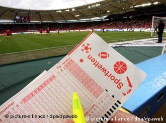 A betting slip in front of a football stadium