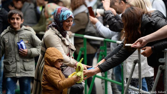 Прием беженцев на вокзале в Мюнхене осенью 2015 года