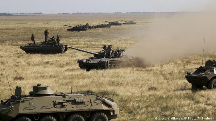 Ukrainian forces amass near the country's de facto border with annexed Crimea