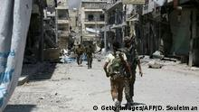 07 08 2016 Members of the Syrian Democratic Forces (SDF) patrol a street in the northern Syrian town of Manbij on August 7, 2016, as they comb the city in search of the last remaining jihadists, a day after they retook it from the Islamic State group. A coalition of Arab and Kurd fighters on August 6, 2016 seized the Islamic State (IS) group stronghold of Manbij, two months after launching an operation to capture the strategic city in northern Syria, a monitor said. The town had served as a key transit point along IS's supply route from the Turkish border to Raqa, the de facto capital of its self-styled Islamic 'caliphate'. / AFP / DELIL SOULEIMAN (Photo credit should read DELIL SOULEIMAN/AFP/Getty Images) Getty Images/AFP/D. Souleiman