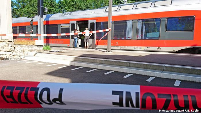 Police stand on Salez station, after the train attack