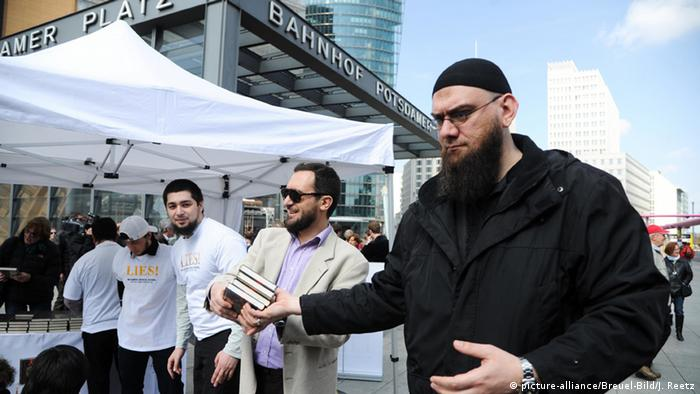 Salafists in Berlin distribute copies of the Holy Koran
