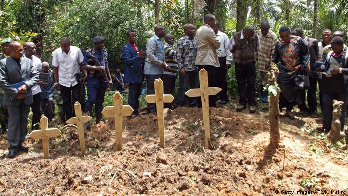 A burial ceremony for victims of an attack by suspected Ugandan Islamist rebels from the ADF.