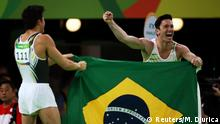 2016 Rio Olympics - Artistic Gymnastics - Final - Men's Floor Final - Rio Olympic Arena - Rio de Janeiro, Brazil - 14/08/2016. Arthur Mariano (BRA) of Brazil and Diego Hypolito (BRA) of Brazil celebrate after taking bronze and silver respectively. REUTERS/Marko Djurica FOR EDITORIAL USE ONLY. NOT FOR SALE FOR MARKETING OR ADVERTISING CAMPAIGNS.
