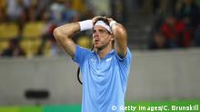 RIO DE JANEIRO, BRAZIL - AUGUST 14: Juan Martin Del Potro of Argentina reacts after defeat in the men's singles gold medal match against Andy Murray of Great Britain on Day 9 of the Rio 2016 Olympic Games at the Olympic Tennis Centre on August 14, 2016 in Rio de Janeiro, Brazil. (Photo by Clive Brunskill/Getty Images)