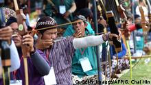 May 8, 2016 This picture taken on May 8, 2016 shows archers in traditional outfits compete in the centuries-old Indonesian sport of 'Jemparingan' in Yogyakarta. The local archery known as 'Jemparingan' has been played for centuries around the ancient kingdom of Yogyakarta, Java island's cultural heartland where Buddhist and Hindu temples sit amid bottle-green paddy fields. After decades of decline, a revival is under way as a new generation of enthusiasts pick up bows and arrows for the first time, and elderly archers seek to pass their skills down to youngsters before they are lost forever. / AFP / GOH CHAI HIN / TO GO WITH AFP STORY: ' Indonesia-archery-culture-INA' Feature by Olivia RONDONUWU (c) Getty Images/AFP/G. Chai Hin