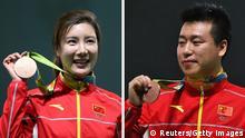 Sportlerpaar Du Li Pang Wei Schützen
