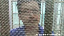 In this December 2014 photo, Yang Maodong, better known by his penname Guo Feixiong, sits in a detention center in Guangzhou in southern China's Guangdong province. The sister of a prominent imprisoned Chinese political activist said Friday, May 6, 2016, that she fears her brother is seriously ill and is urging the authorities to allow him access to better medical treatment, in what an international rights group said is the latest example of China routinely denying political prisoners adequate care. Copyright: picture-alliance/AP Photo