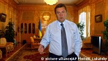 July 15, 2004 Ukraine's Prime Minister Viktor Yanukovych is seen during his interview to the Associated Press in his cabinet office in Kiev, Ukraine, Thursday, July 15, 2004. According to the most recent opinion poll conducted by the Kiev-based Razumkov Center think tank, more than 25 percent of voters favor leading opposition candidate Viktor Yushchenko for the post of president, while some 17 percent favor Yanukovych. Elections are due this fall. (AP Photo/Efrem Lukatsky) | (c) picture-alliance/AP Photo/E. Lukatsky