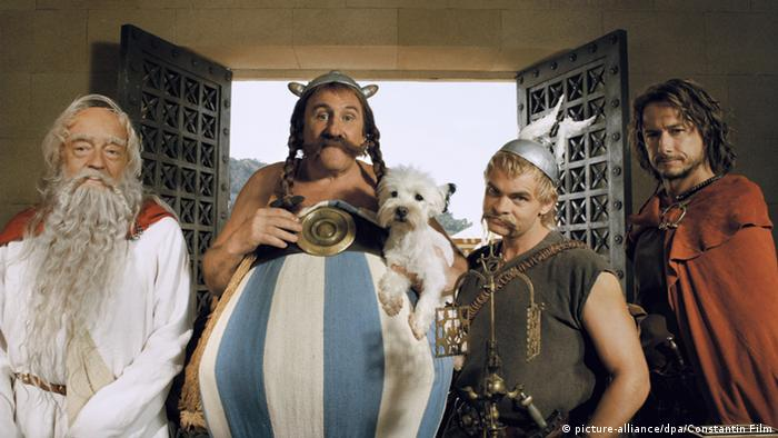 Film still 'Asterix at the Olympic Games': Miraculix (l-r, Jean-Pierre Cassel), Obelix (Gerard Depardieu) with Idefix, Asterix (Clovis Cornillac) and Romantix (Stephane Rousseau)