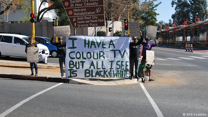 Johannesburg Friday protest SOS Coalition. A poster reads: I have a color TV but all I see is black and white