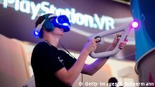 GERMANY - AUGUST 17: A Visitor try out a VR game at the Sony Play Station stand at the Gamescom 2016 gaming trade fair during the media day on August 17, 2016 in Cologne, Germany. Gamescom is the world's largest digital gaming trade fair and will be open to the public from August 18-21. (Photo by Sascha Schuermann/Getty Images) Copyright: Getty Images/S. Schuermann