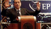 Italian Premier Silvio Berlusconi gestures at the opening of the EPP-ED (European People's Party and European Democrats) group study day in Rome, Wednesday, March 29, 2006, a day before the opening of the EPP Congress in Rome. (AP Photo/Alessandra Tarantino)