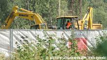 epa05492410 A digger works around the area on the 65th kilometer of the railway track Wroclaw-Walbrzych, during an attempt to explore the existence of the so-called 'Nazi Gold train', in Walbrzych, Poland, 17 August 2016. Piotr Koper and Andreas Richter, who reported finding the so-called 'Nazi Gold train' in August 2015, have started the final excavation of the train. More than 60 people are taking part in the project, including engineers, chemists, geologists and archeologists. The search is expected to last two weeks, with plans for three excavations 30 metres apart from one another, each with a length of about 100 metres. EPA/MACIEJ KULCZYNSKI POLAND OUT EPA/MACIEJ KULCZYNSKI POLAND OUT   Copyright: picture-alliance/dpa/M. Kulczynski