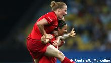 Rio_Momente_19_08 19.08.2016 *** 2016 Rio Olympics - Soccer - Final - Women's Football Tournament Gold Medal Match - Maracana - Rio de Janeiro, Brazil - 19/08/2016. Melanie Behringer (GER) of Germany leaps on Dzsenifer Marozsan (GER) of Germany as they celebrate goal during the second half. REUTERS/Ueslei Marcelino FOR EDITORIAL USE ONLY. NOT FOR SALE FOR MARKETING OR ADVERTISING CAMPAIGNS. © Reuters/U. Marcelino