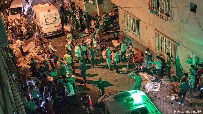 Ambulances arrive at the site of an explosion in Gaziantep following a late night militant attack on a wedding party