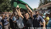 People carry a coffin during a funeral for victims of last night's attack on a wedding party that left 50 dead in Gaziantep in southeastern Turkey near the Syrian border on August 21, 2016. At least 50 people were killed when a suspected suicide bomber linked to Islamic State jihadists attacked a wedding thronged with guests, officials said on August 21. Turkish President Recep Tayyip Erdogan said the IS extremist group was the 'likely perpetrator' of the bomb attack, the deadliest in 2016, in Gaziantep late Saturday that targeted a celebration attended by many Kurds. / AFP / AHMED DEEP (Photo credit should read AHMED DEEP/AFP/Getty Images) Copyright: Getty Images/AFP/A. Deep