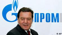 Former German Chancellor Gerhard Schroeder walks in Russian natural gas monopoly Gazprom headquarters in Moscow, Thursday, March 30, 2006. Former German Chancellor Gerhard Schroeder on Thursday was awarded a euro 250,000 (US$300,000) salary after being appointed chairman of the consortium building a strategically vital gas pipeline linking Russia's vast reserves with German markets. Letters in Cyrillic read : Gazprom. (AP Photo/ Alexander Zemlianichenko )