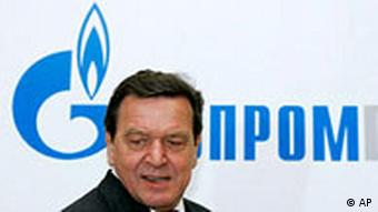 Former German Chancellor Gerhard Schroeder walks in Russian natural gas monopoly Gazprom headquarters in Moscow, Thursday, March 30, 2006.
