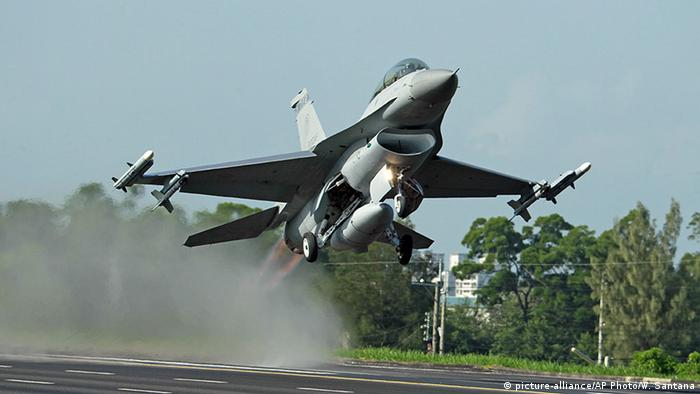 A Taiwan Air Force F-16 fighter jet takes off from a closed section of highway in central Taiwan