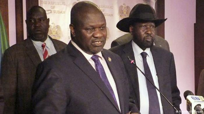 South Sudan rebel leader and then vice president Riek Machar, stands at microphone, in front of President Salva Kiir in Juba.