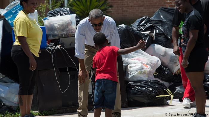 President Barack Obama speaks to a young boy
