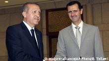 Syrien Recep Tayyip Erdogan und Bashar Assad (picture-alliance/AP Photo/B. Tellawi)