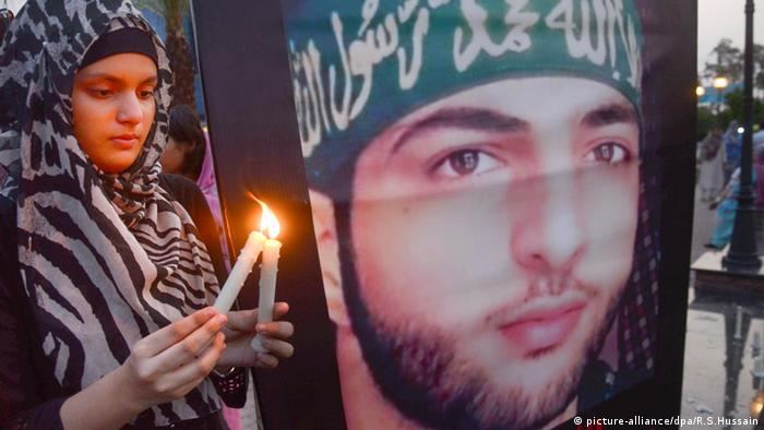 Pakistan activist participating in candle light vigil during an anti-Indian protest