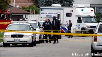 Police arrived in force at the Scene of the murders in Toronto