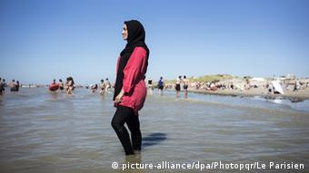Woman in full-body covering at Fort Mahon Beach in France