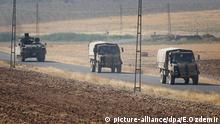 Türkische Soldaten auf einem Panzer bei der Rückkehr von einem Einsatz in Syrien
