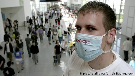 Man wearing mask to protect against swine flu