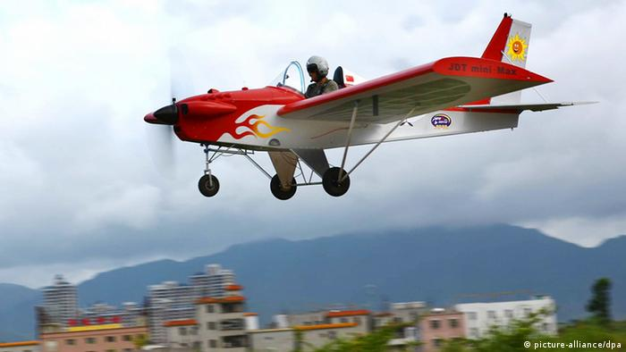 Yang Weimin flies his self-made light plane during the maiden flight in Shenzhen city