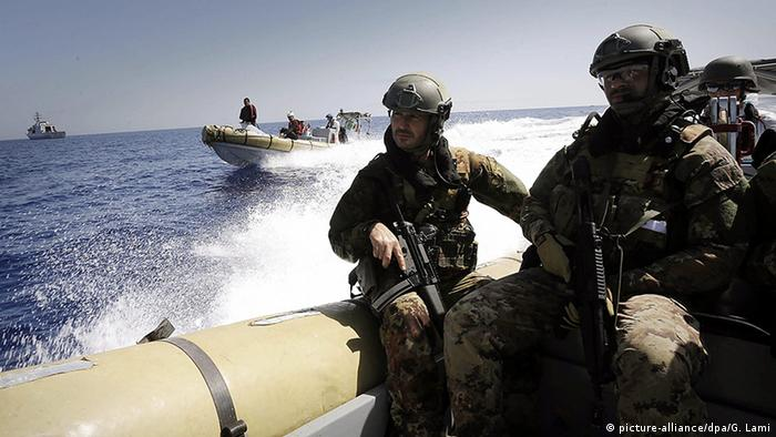 Italian soldiers on dinghies in the Mediterranean sea