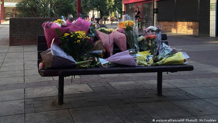Flowers are placed near the scene of an attack that resulted in the death of a Polish man, in Harlow, England, Tuesday, Aug. 30, 2016. British police have arrested six teenagers suspected of murdering a Polish man in a possible hate crime,