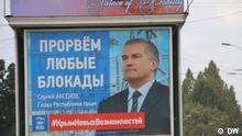 Wahlkampf (russische Parlamentswahlen) auf der Krim Billboards der Kandidaten von Einiges Russland Sergej Aksjonow und Andrej Kosenko, owie Agitbroschüren von unterschiedlichen Kandidaten. Copyright: DW