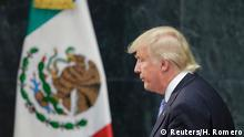 August 31, 2016+++++++++U.S. presidential nominee Trump finishes a press conference in Mexico City U.S. Republican presidential nominee Donald Trump walks past a Mexican flag after giving a press conference with Mexico's President Enrique Pena Nieto at the Los Pinos residence in Mexico City, Mexico, August 31, 2016. REUTERS/Henry Romero (c) Reuters/H. Romero