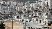 A picture taken on April 14, 2016 shows a partial view of the Israeli settlement of Givat Zeev near the West Bank city of Ramallah. Israel has approved plans for more than 200 new settler homes in the occupied West Bank, adding to a sharp increase in settlement projects so far this year, Israeli campaigners said.Israel's government disputed the claim, saying nearly all approvals involved 'upgrading existing structures' and not new construction, without providing a more detailed breakdown. Settlements are considered illegal under international law and are seen as major stumbling blocks to peace efforts since they are built on land the Palestinians see as part of their future state. According to Peace Now and Israeli media, the new plans call for additional homes in a range of settlements. They include Har Brakha (54 units) near Nablus in the northern West Bank; Revava (17), also in the northern West Bank; Ganei Modiin (48), northwest of Jerusalem; Tekoa (34), south of Jerusalem; and Givat Zeev (76), north of Jerusalem. / AFP / THOMAS COEX (Photo credit should read THOMAS COEX/AFP/Getty Images) +++ (C) Getty Images/AFP/T. Coex