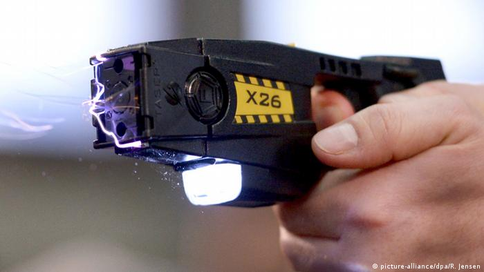 A taser is used in a demonstration by a police officer in Berlin