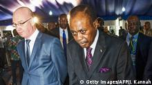 Sept. 1 , 2016 Former Togolese Prime Minister Edem Kodjo (R) walks with officials during the opening of a Congolese 'National Dialogue' in the Democratic Republic of Congo's capital Kinshasa on September 1, 2016. Former Togo Prime Minister Edem Kodjo is the African Union facilitator for this meeting scheduled to last two weeks and aimed at paving the way for 'peaceful elections' in the Central African country. / AFP / JUNIOR D.KANNAH (c) Getty Images/AFP/J. Kannah