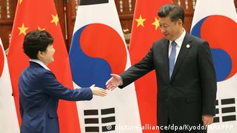 Chinese president Xi Jinping shakes hands with with South Korean counterpart Park Geun-Hye
