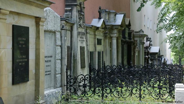 Imposing wall of graves in a city cemetery