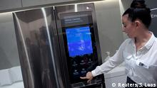 02.09.2016+++ An assistant presents a smart home refrigerator by LG at the IFA Electronics show in Berlin, Germany September 2, 2016. +++ (C) Reuters/S. Loos